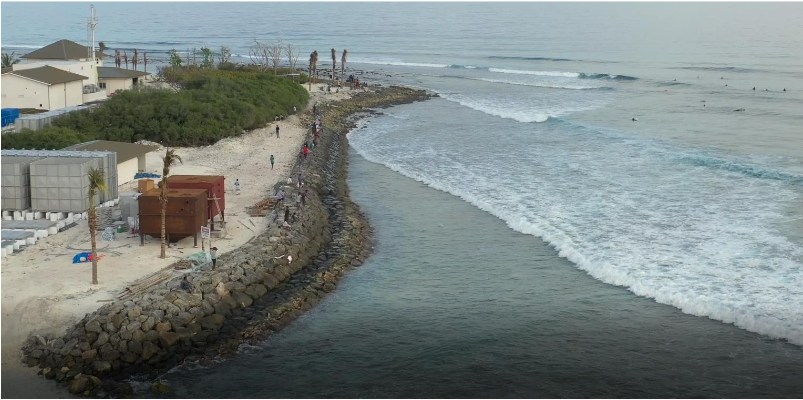 Difference between natural shoreline (at the top of the photo) and artificial one: even on a pretty average day, you can see backwash affecting the end section of the wave.